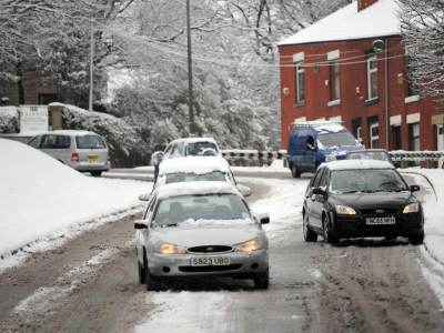 Drivers struggle in the snow in Cheshire